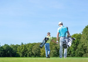 Father and son playing golf using lifestyle membership