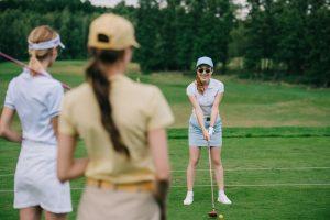 Ladies playing golf