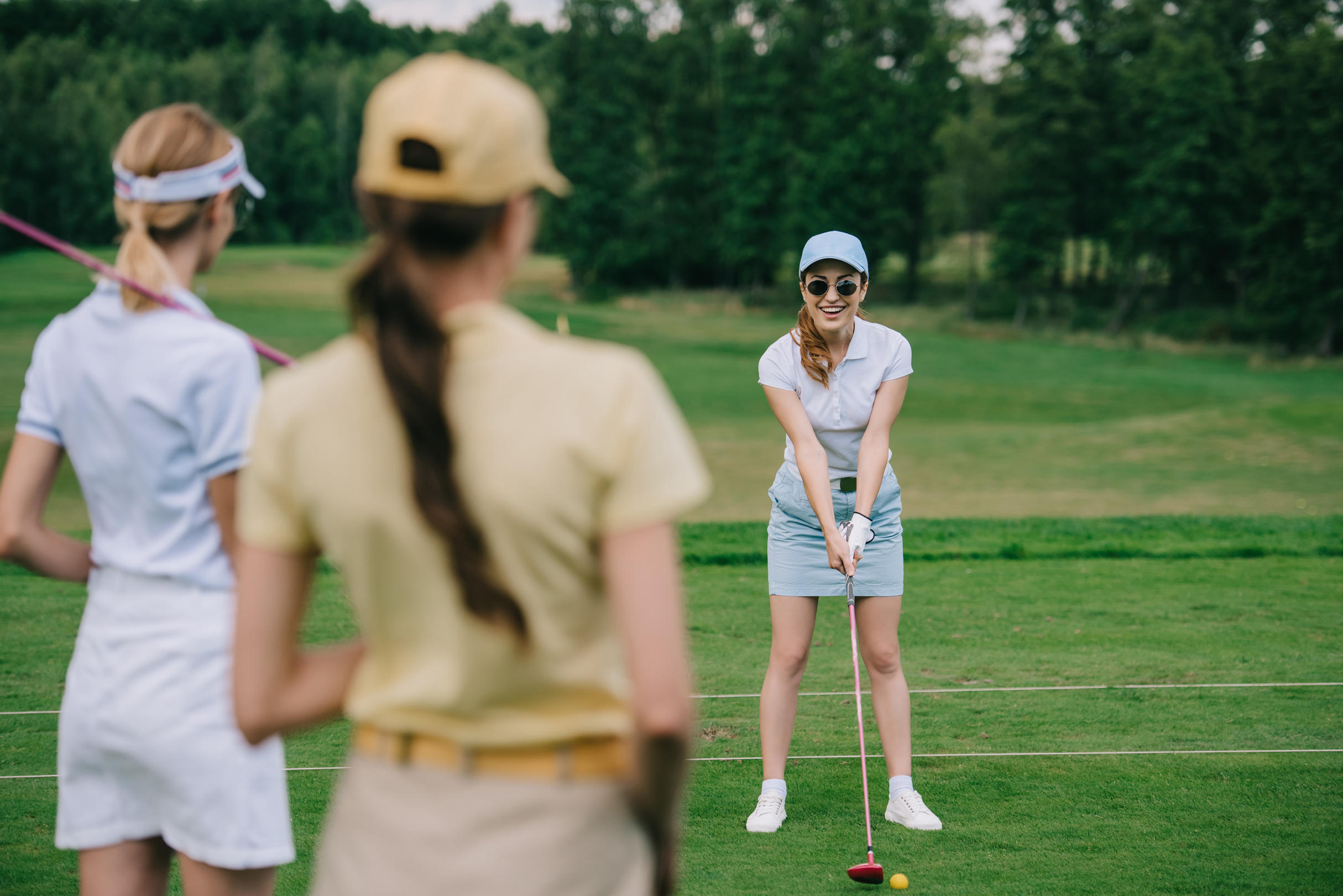 Ladies playing golf