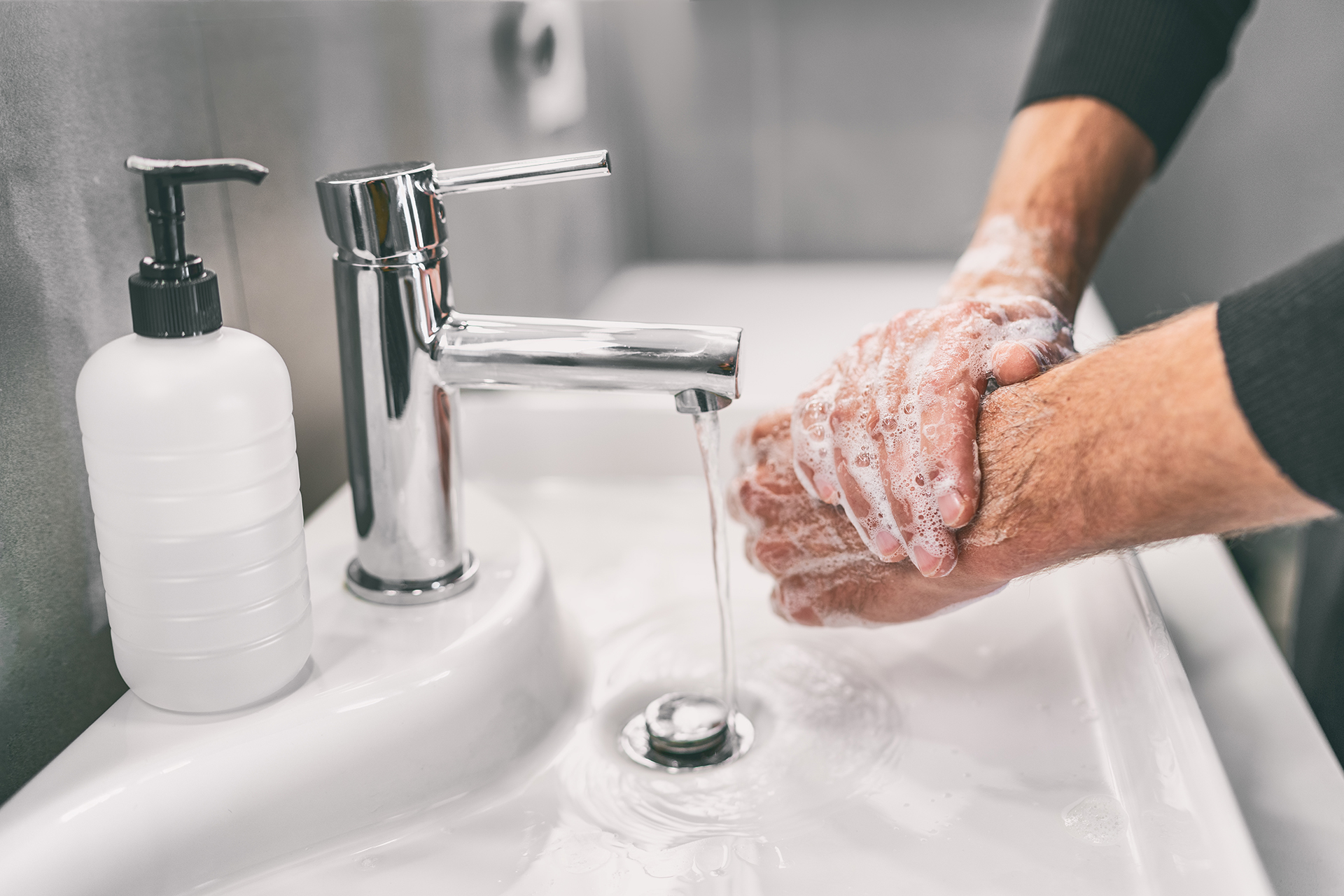 Washing hands to prevent the spread of COVID-19